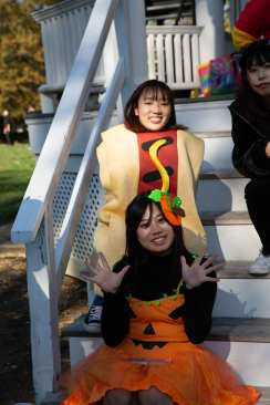 A pumpkin and a hot dog join in the fun at the ELI Halloween picnic.