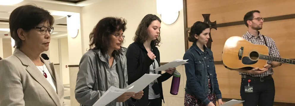 Faculty pray and sing during Mercy Day 2018