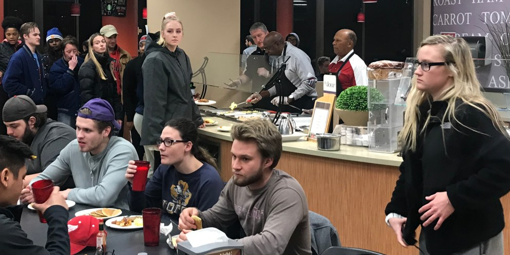 Faculty help dish out food at late night breakfast