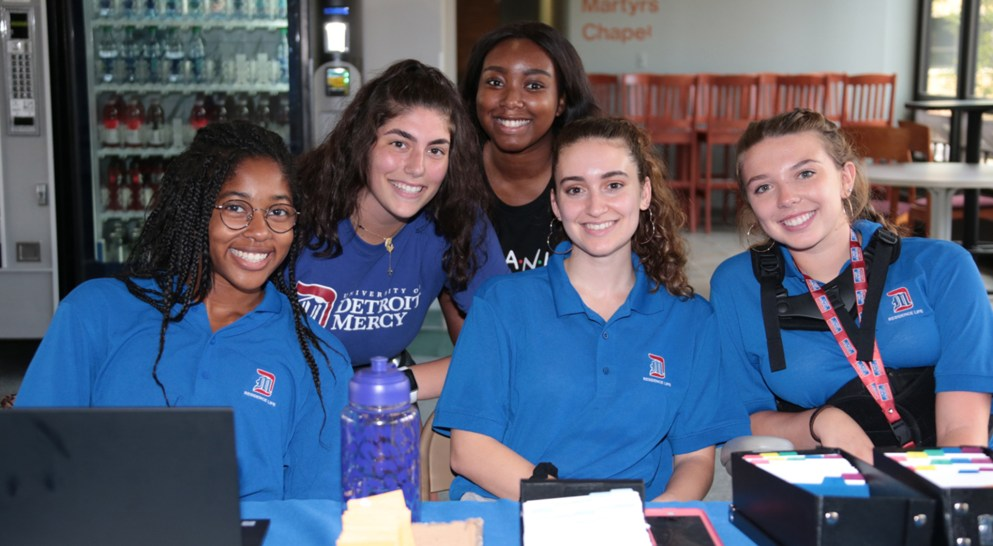 Detroit Mercy orientation leaders smile and welcome students to campus.