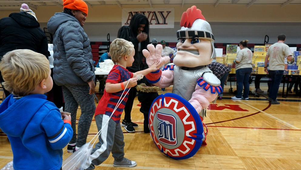 Kids drop in and high five Tommy Titan at Project Toy Drop.