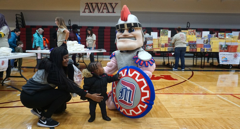 Children come and hang with Tommy Titan at Project Toy Drop.