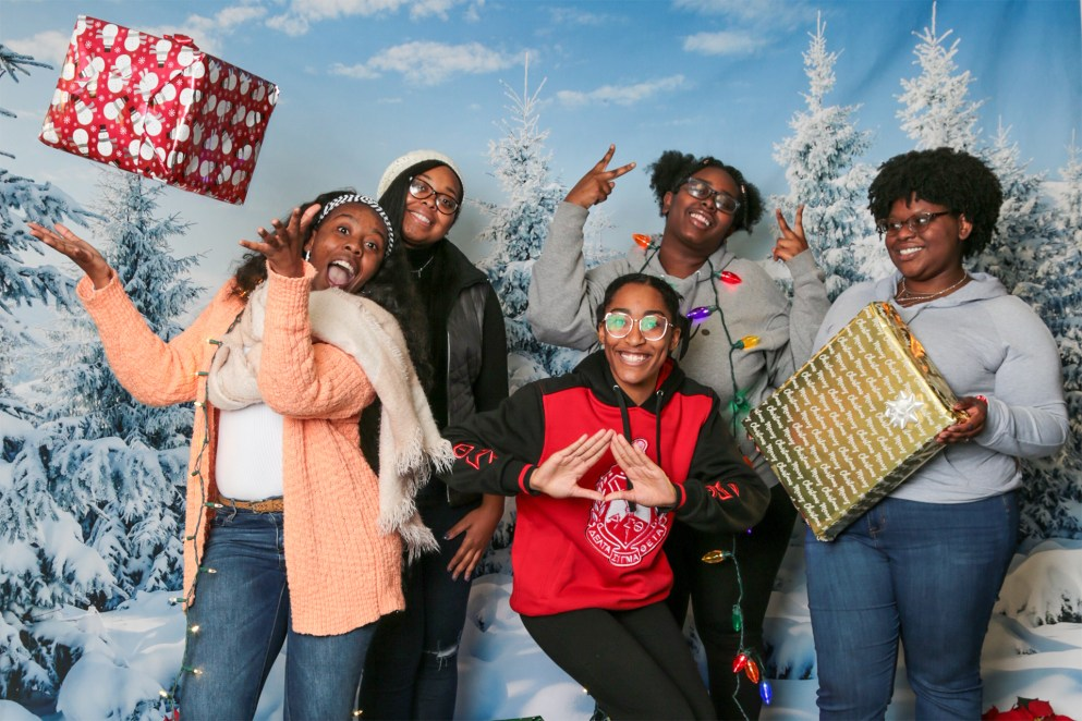 Students spread some holiday cheer at the Late Night Breakfast.