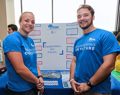 Brynne Gustafson, left, poses at the Student Org Fair.