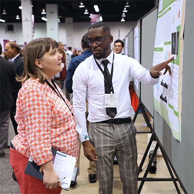 Mitchell Mims, right, presenting his research findings.