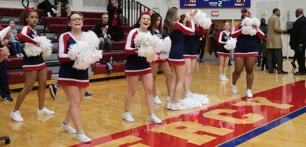 Taylor Kile, pictured center, cheering on the Detroit Mercy Titans with the cheer team.