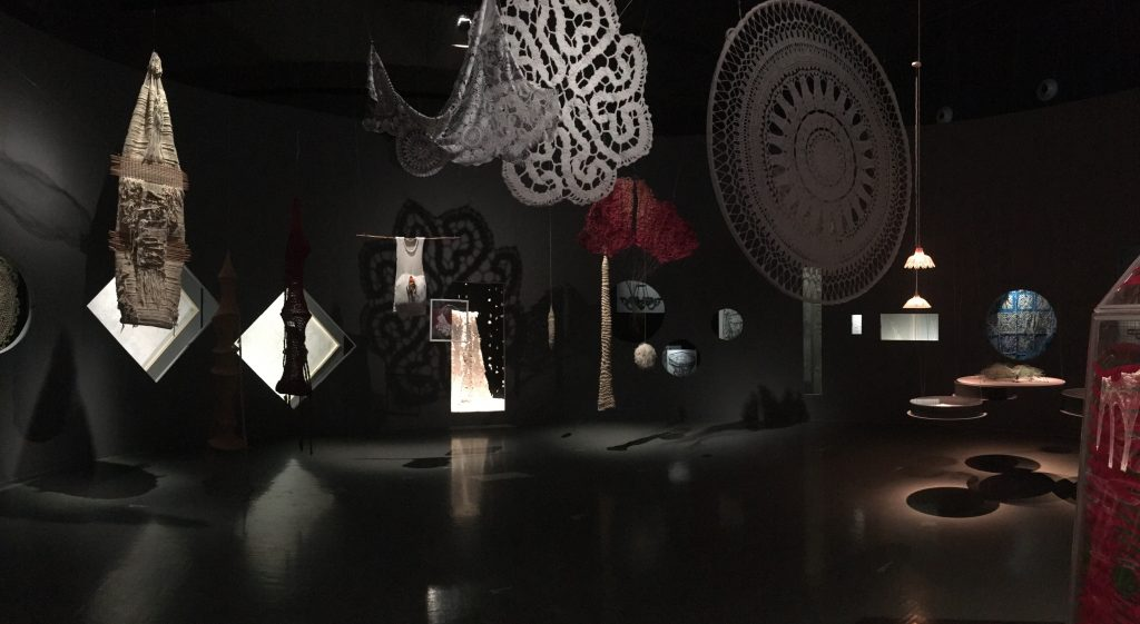 First view when entering exhibit; giant doilies hanging from ceiling