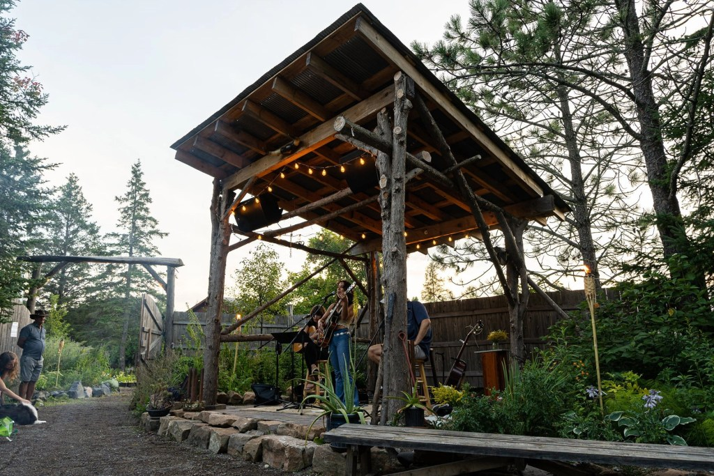 Utopia Borealis Stage and fire pit area at Sitio Weddings + Events - A wedding and event venue just south of Duluth, MN.