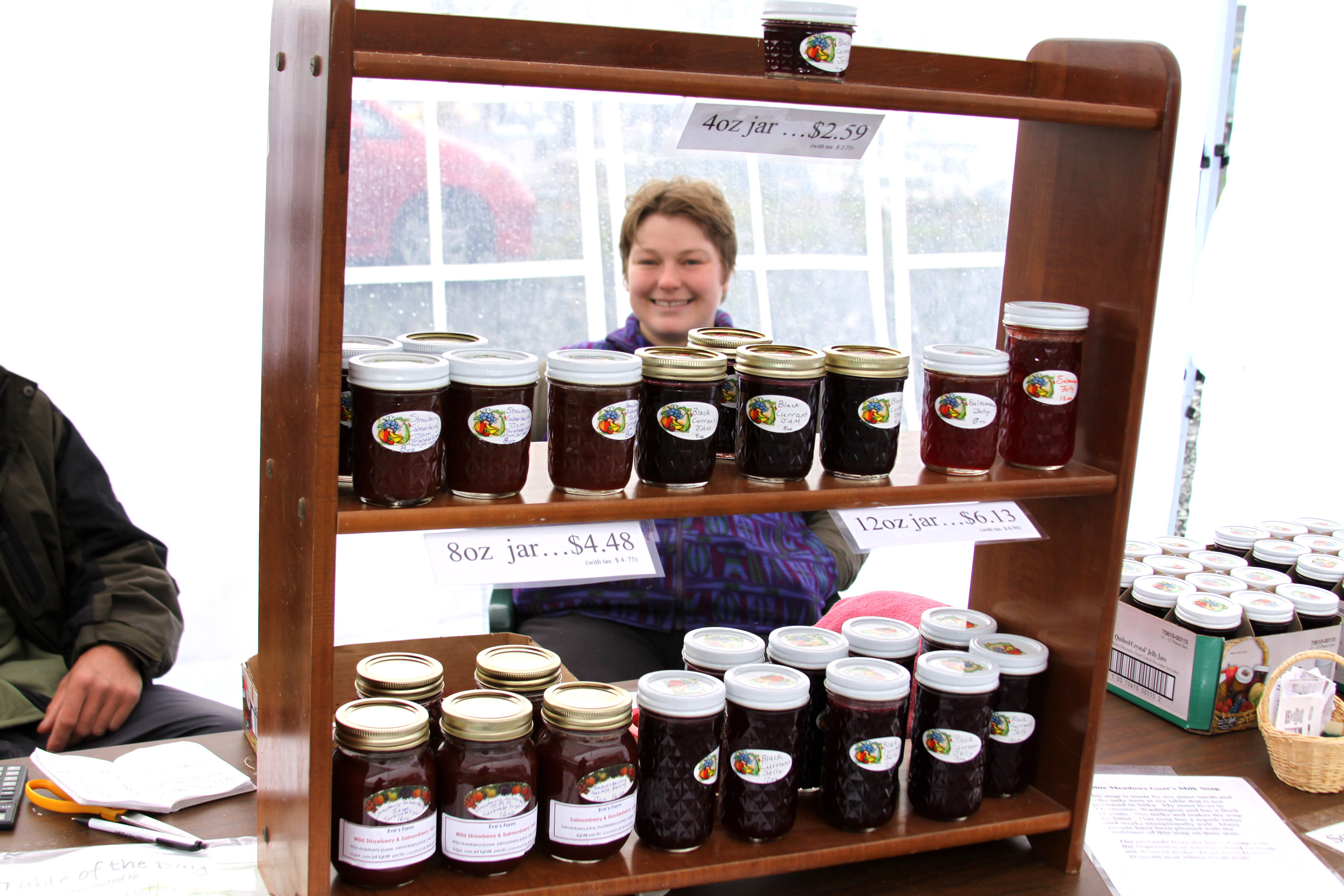 Evening Star Grutter and a rack of her homemade jams and jellies
