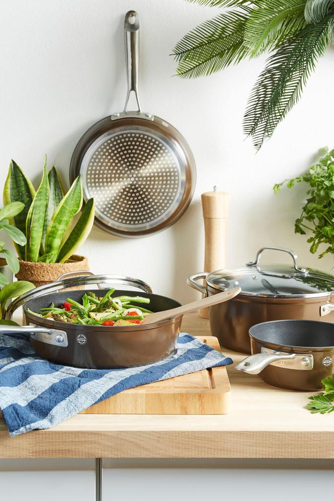 Recycled brown aluminum fry pan with food