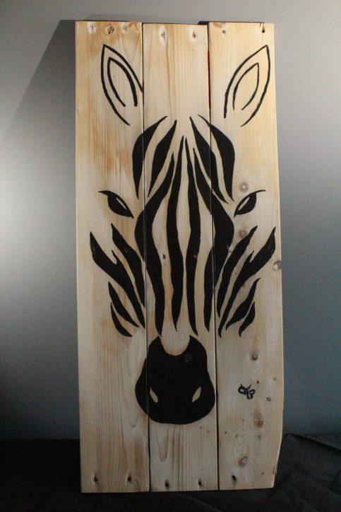 Zebra painted on wooden slats