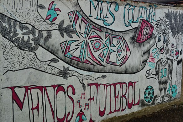 """Mais Cultura, Menos Futebol"" (More Culture, Less Football). I really liked this picture of graffiti in Brazil. (Photo by Marcos Torres, used with permission)"