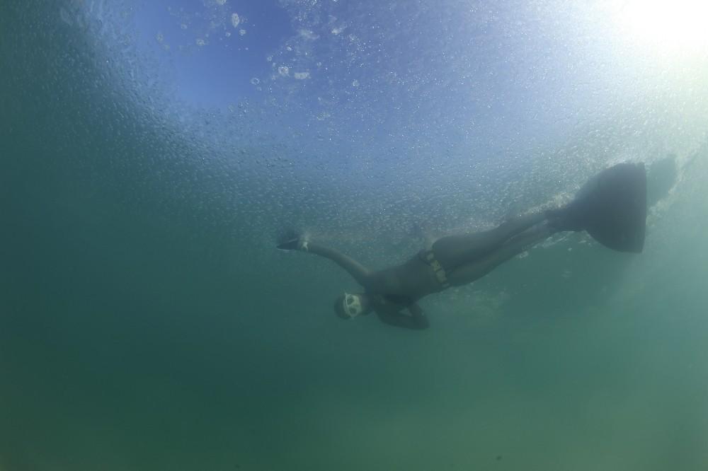 Eriyen buz tabakası rekortmen sporcuya sürpriz yaşattı
