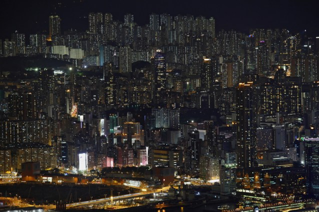 Buildings are seen on a hillside in Hong Kong June 19, 2012. Hong Kong's main shopping district is gaining on New York's 5th Avenue for the title of world's most expensive retail zone as rents rise by 35 percent a year, pushing chains such as H&M out to the cheaper suburbs. Space has always been at a premium in Hong Kong, an island-city, like Manhattan, where developers plant high-rises on every available inch. Retail rents in prime shopping areas are rising more rapidly here than in New York, London or Paris. REUTERS/Bobby Yip (CHINA - Tags: CITYSPACE ENVIRONMENT REAL ESTATE BUSINESS) - RTR35A1P
