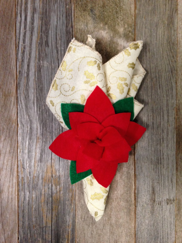 No Sew Project | Christmas | Christmas Decorations | Christmas Decor DIY | Christmas Crafts | Christmas Place Settings | Christmas Planning | Poinsettia | Poinsettia Napkin Rings | Christmas Crafts DIY | Looking for an easy no sew Christmas craft? You'll love how easy these are to make. All you need is some felt and our free pattern and you'll have these poinsettia napkin rings made in no time! Six Clever Sisters has the tutorial.