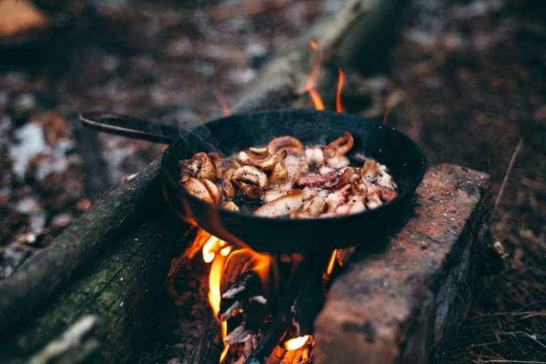 Knowing how to cook over an open fire is so important if you are going camping or are practicing your survival skills. It's not as hard as you think! Let me show you my favorite campfire cooking tips to to make your camping recipes taste amazing!