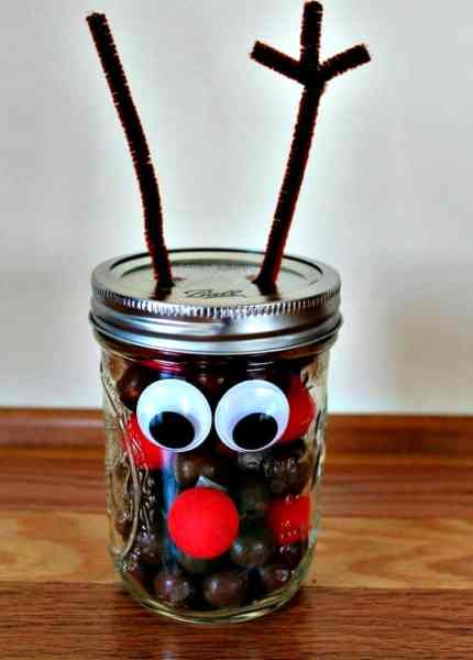 Kids Mason Jar Christmas Craft Idea - Looking for an adorable kids craft idea? These reindeer noses are one of the cutest mason jar crafts ever!