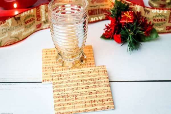 Need a quick, but beautiful homemade Christmas gift idea? These DIY coasters are perfect! We use Christmas sheet music to create a wonderful and functional keepsake they'll remember forever. Plus, these DIY tile coasters are super simple to make!