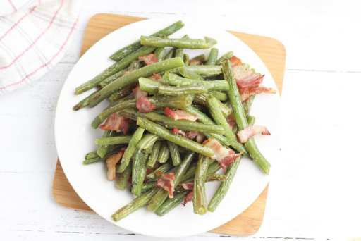 Take your green bean recipe to the next level with this roasted green bean recipe! Even picky eaters love this roasted green bean with bacon recipe!