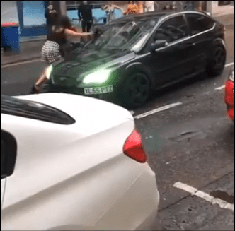 Dramatic roadrage incident ends in driver knocking down passerby (video)