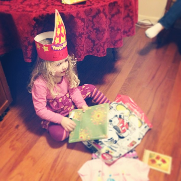 Opening gifts from Nana and Grandpa Tom!