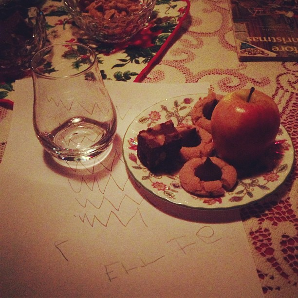 Cookies and milk for Santa, with an apple for the reindeer
