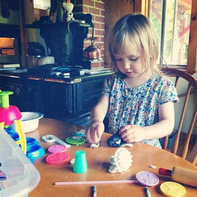 Making up stories with her play dough