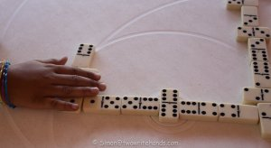 Child playing dominos