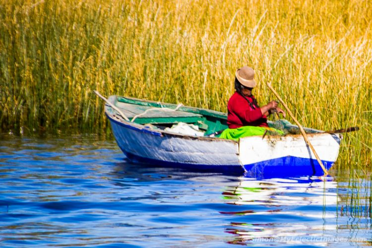 Peruvian Lady Fishing in the Reed Beds Around Uros on Lake Titicaca (©simon@myeclecticimages.com)