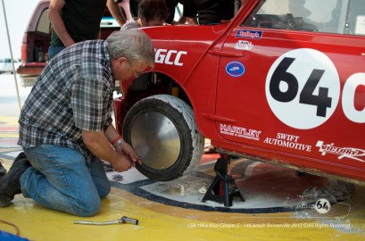 Larry Mulholland of Swift Automotive attaches one of our home made moon discs. Photo by Mike Wilson ©2012. All Rights Reserved.