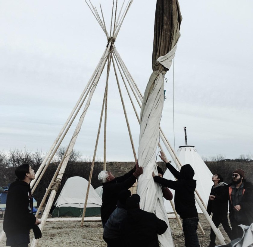 Setting up the tipi at IIYC camp. Photo credit: Luis Raul