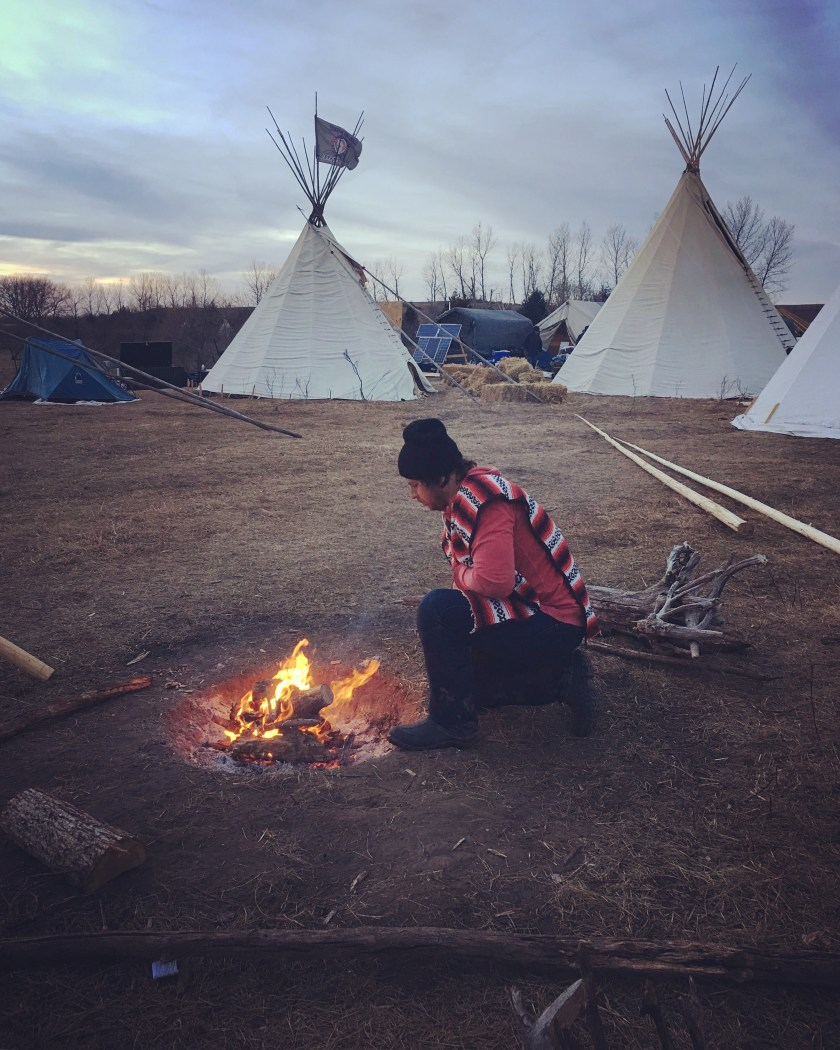 Juan Carlos setting up a fire at the International Indigenous Youth Council camp where we spent the night, Photo credit: Analu M. Lopez