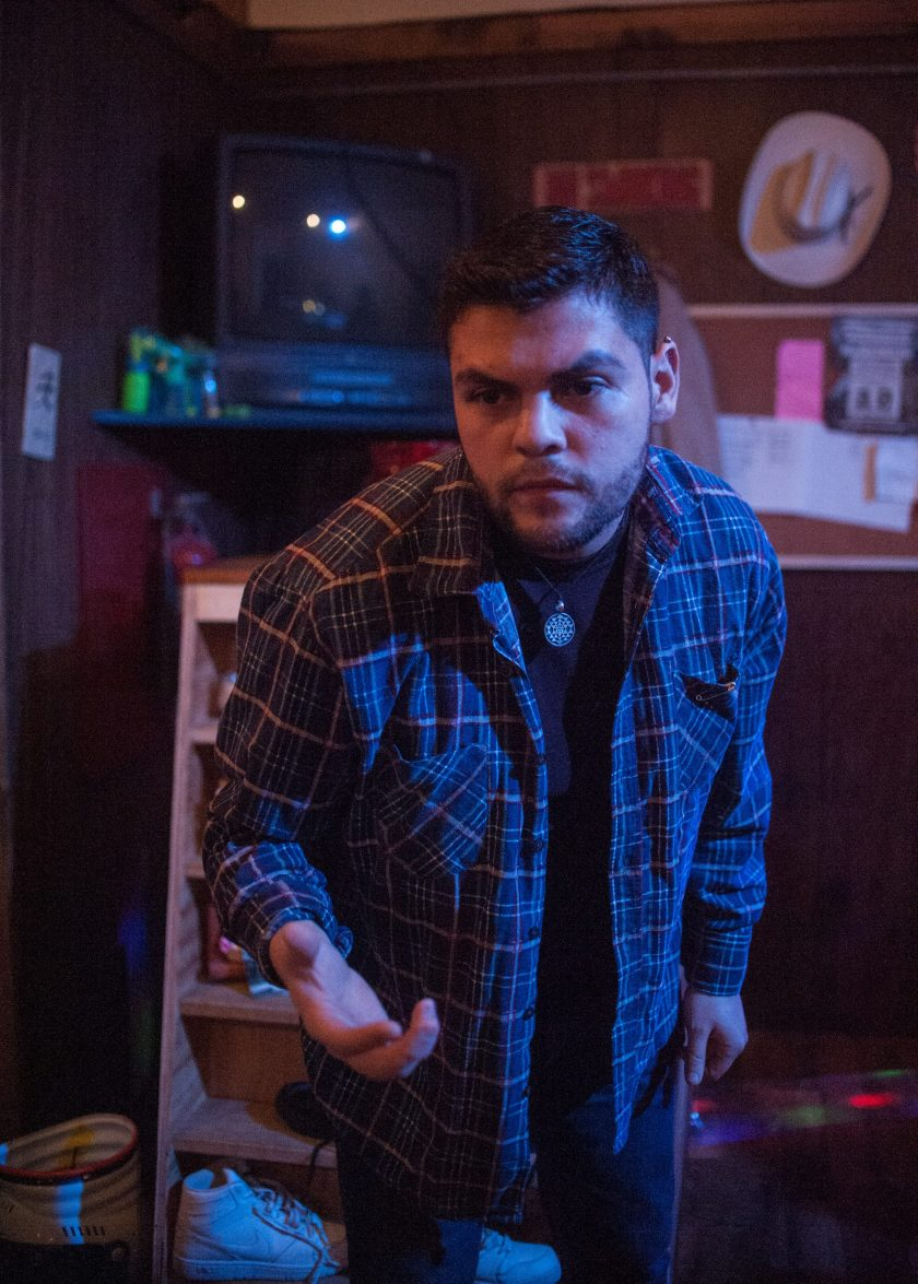 """Anthony Soto leans foward, with his right hand outstretched in a scene from """"Meet Juan(ito) Doe."""" Photo by William Camargo."""