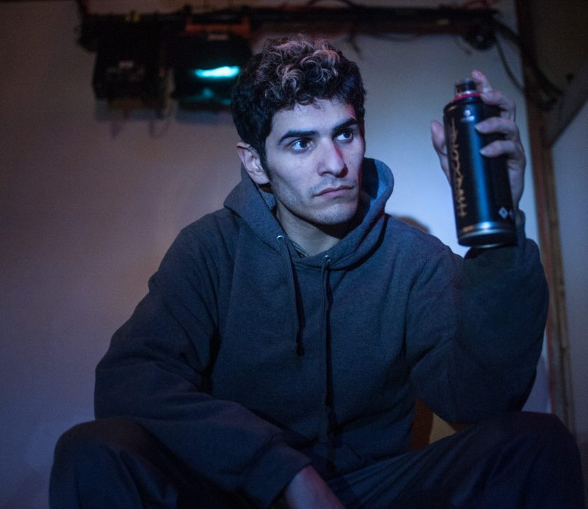 """Nicolas Del Valle Jr. holds a can of spray in a monologue from """"Meet Juan(ito) Doe."""" Photo by William Camargo."""