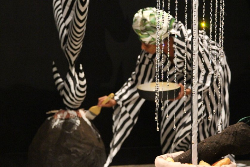 "D. Denenge Duyst-Akpem, image of performance and installation of ""Wan Chuku and Mystical Yam Farm,"" 2015. Image credit: Casey Pankey and Oklahoma State University Museum of Art."