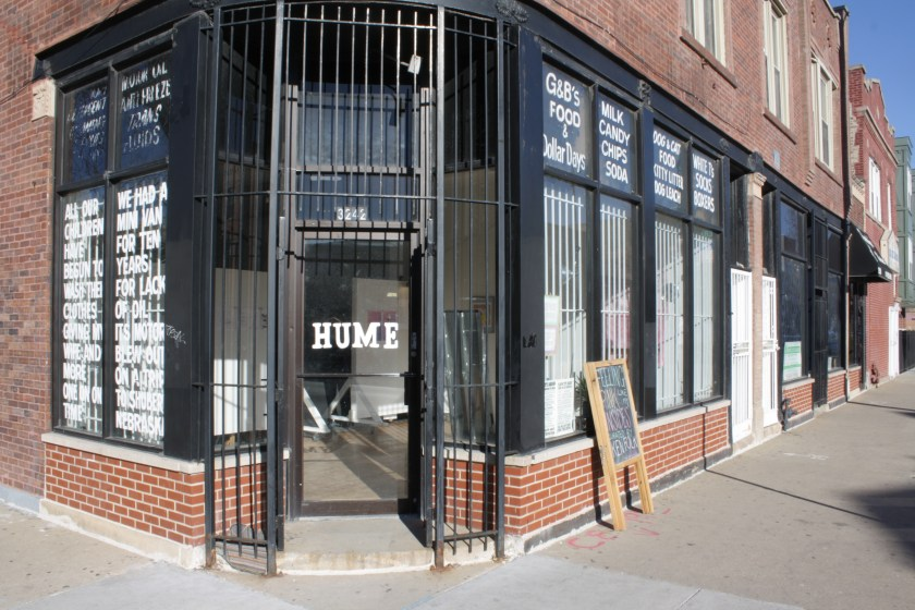 The facade of Hume Chicago, a brick building with black metal bars over the windows. Photo by Hannah Siegfried