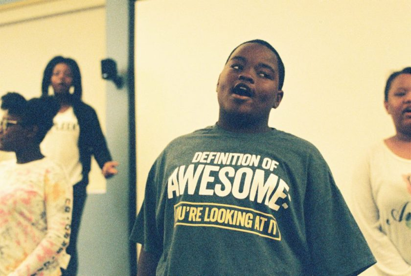 """Image: At the BBF Family Services open house in June, a young person's shirt reads, """"Definition of Awesome: You're looking at it."""" Photo by Eric Roberts."""