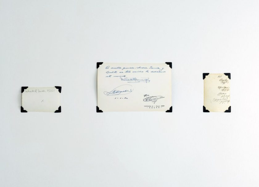 Image: Andre Keichian, 'Salt in the I' (detail), 2019. View of signatures and writing on the reverse sides of three photographs from Keichian's family album, as part of the exhibition installation at table. Photo by Kim Becker. Image courtesy of Kyle Bellucci Johanson.