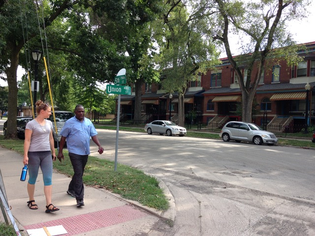 Image: Astrid Kaemmerling shown walking Enos Park being led by participant of the Enos Park Walking Laboratory (2017), Location: 5th Street and Union Street, Enos Park, IL. Photo by Danielle Wyckoff.