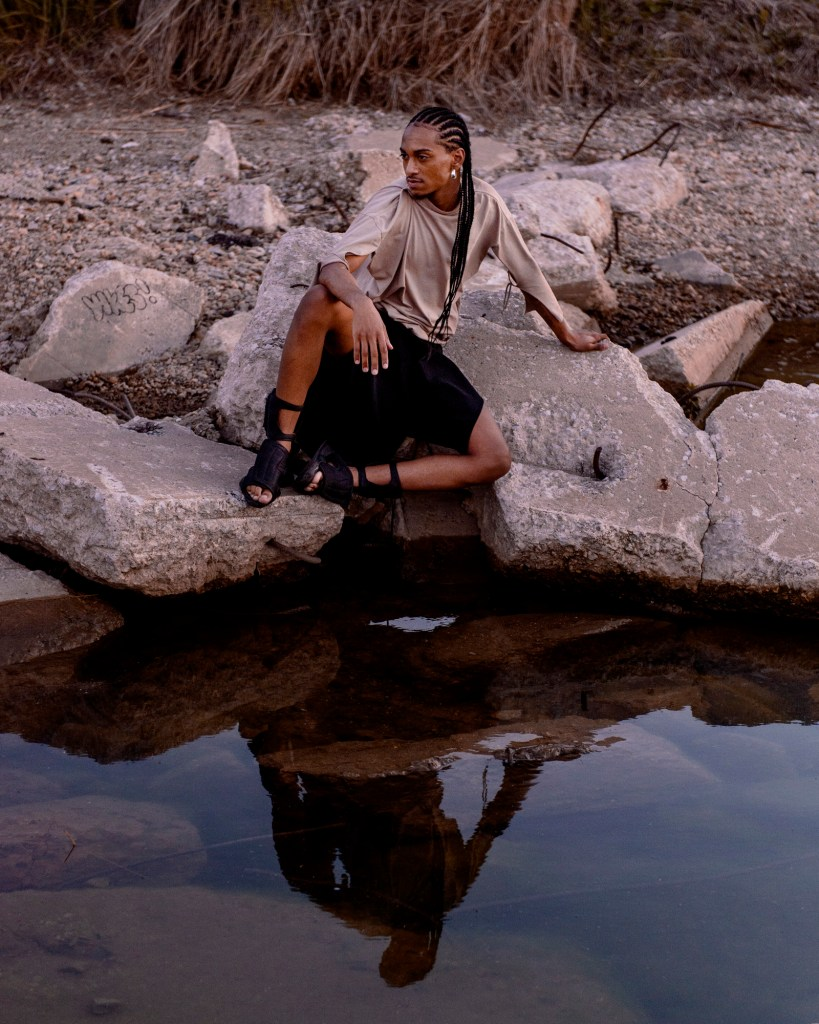 Image: Morenxxx perches on broken pieces of concrete over water. Photo by Ryan Edmund.
