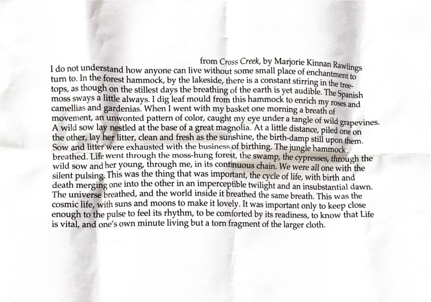 Image: Piece of paper that has been folded several times shows text from Cross Creek by Marjorie Kinnan Rawlings. Text was provided to Moonlight Retreaters upon check-in for the weekend. Photo by Rachel Hausmann Schall.