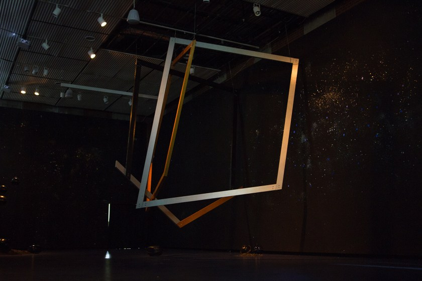 """Image: Installation view of """"Dark Matter: Celestial Objects as Messengers of Love in These Troubled Times"""" by Folayemi Wilson at the Hyde Park Art Center. Detail of """"zora-b:1891.1917.1960.2006"""" sculpture; an inverted representation of a shotgun house frame.. Photo by Michael Sullivan."""