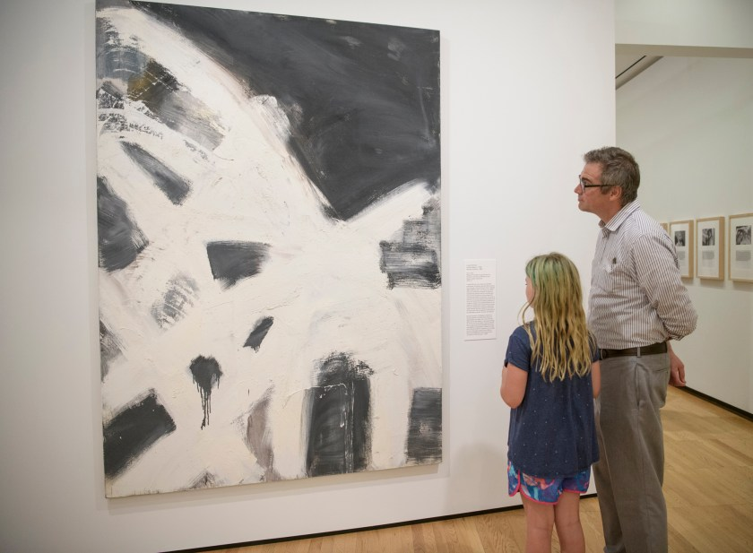 "Image: A man and a young girl look at Louise Fishman's ""Blonde Ambition"" in the exhibition ""Art Since 1948,"" installation view at Krannert Art Museum, University of Illinois at Urbana-Champaign, 2019. Courtesy of Krannert Art Museum. Photo by Della Perrone."