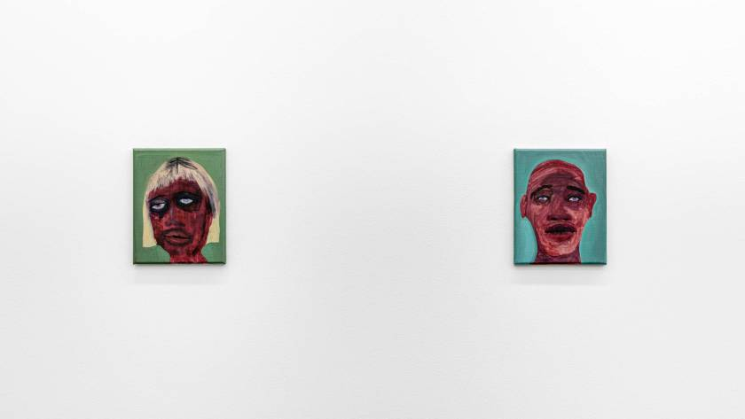 Image: Installation view of the exhibition We Laugh Loud So The Spirits Can Hear, 2020, featuring the work of February James from. Two small scale oil-painted portraits hang on a wall. The dark-skinned faces are depicted in a washy style, which creates a stark contrast to the flat backgrounds of sage green (left) and turquoise (right). Image courtesy of the artist and Monique Meloche Gallery.