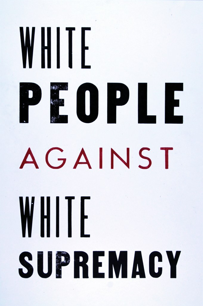 "Image: Emmy Lingscheit, Against White Supremacy, 19 x 12.5 inches, Letterpress, 2020. On white paper, the black text reads ""White People Against White Supremacy."" Text is printed in black except for the word ""against."" One typeface is used for the words ""white,"" a different typeface is used for ""against,"" and another for ""people"" and ""supremacy."" Image courtesy of Emmy Lingscheit."
