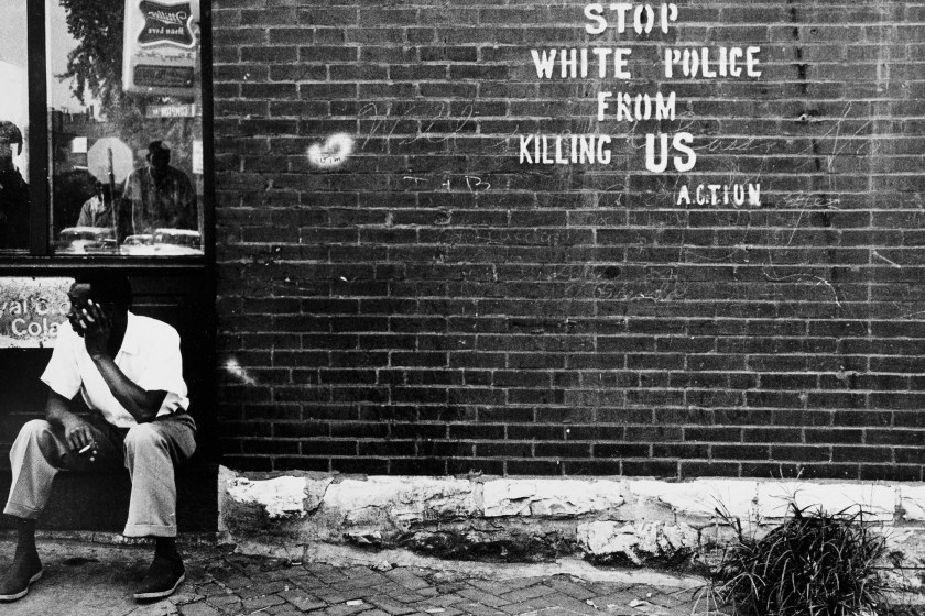 A black and white photograph titled Stop White People From Killing Us - St. Louis, MO, c. 1966-1967 by Darryl Cowherd