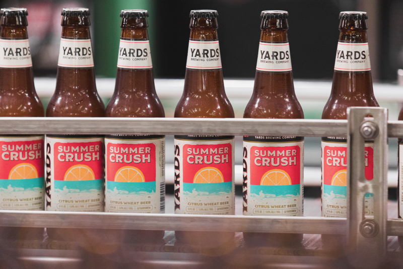 Yards Brewing Company Summer Crush bottles coming off the bottling line