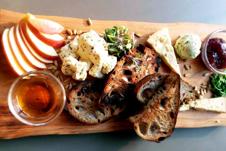 A cheese plate from the innovative farm to table menu at Hidden River Brewing Company