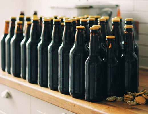 Why We Brew - A few freshly capped home brew bottles