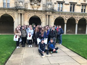 A school visit group gathers for a photo in Canterbury Quad
